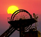 colliery wheel against sunset